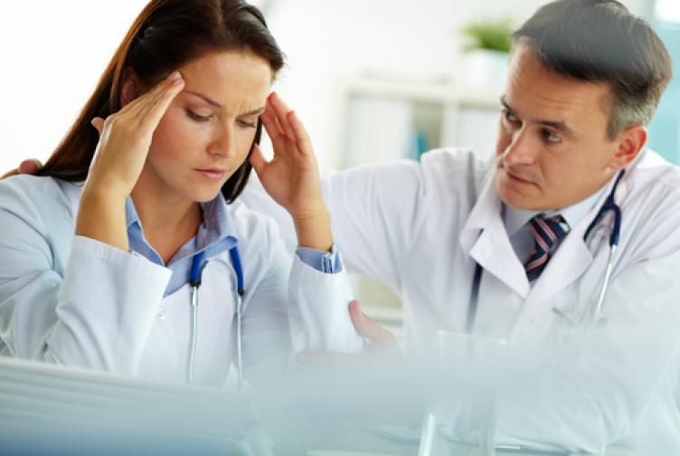 Doctor comforting a distressed colleague